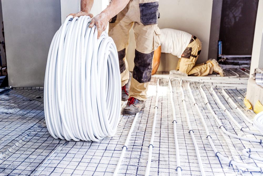 Pipe,Fitter,Mounted,Underfloor,Heating.,Heating,System,And,Underfloor,Heating.
